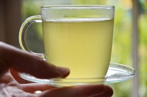 Drink green tea - How to Reduce Bloating and Belly Fat Fast: 8 Remedies