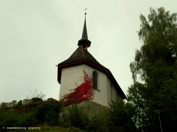 A spray of red leaves on a village chapel