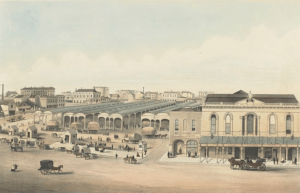 Shows view of the market at the corner of Exhibition and Bourke Streets, with Haymarket Hotel at the right of picture, stall-holders and customers and horse-drawn vehicles