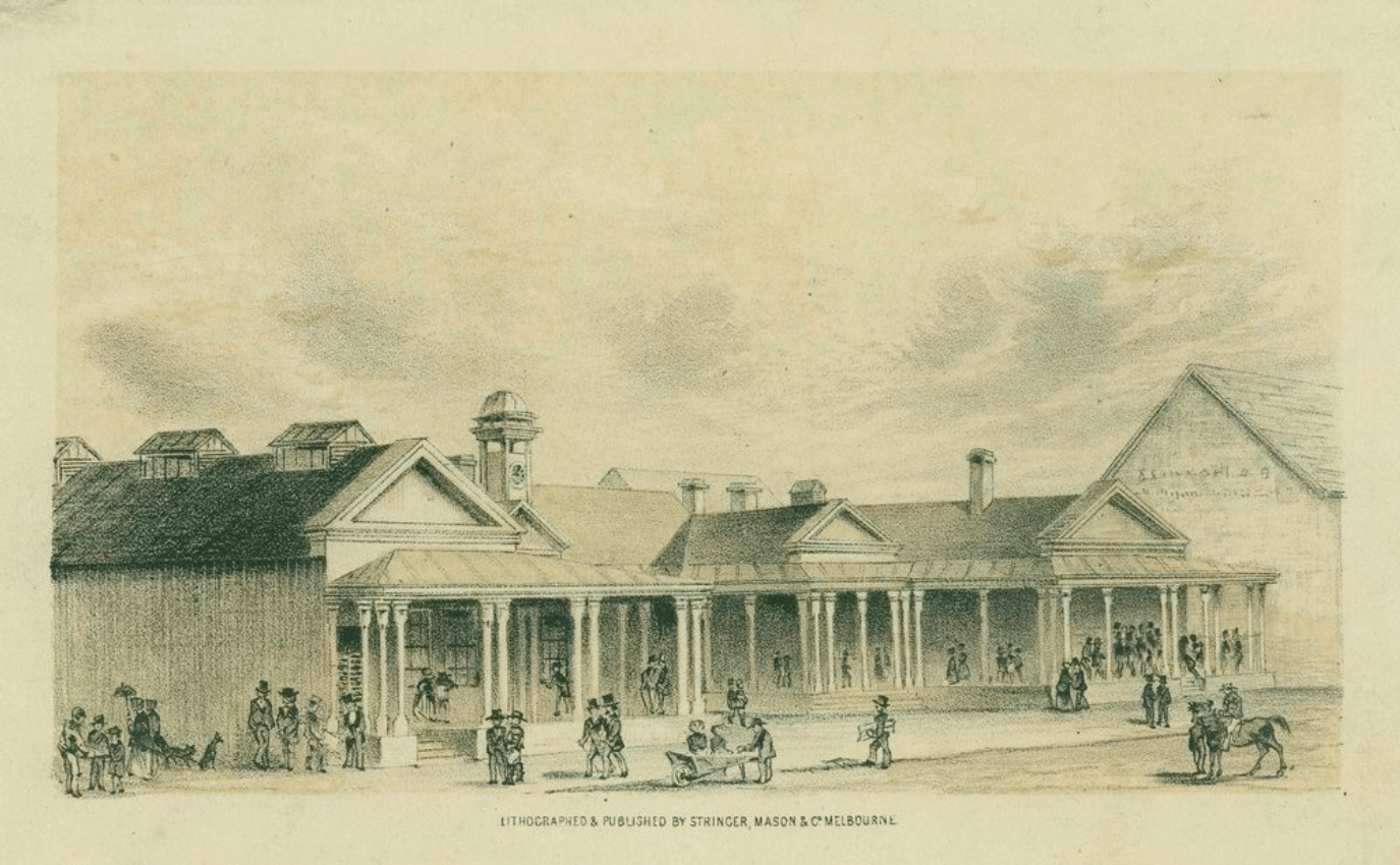 """Shows facade of post office, building in """"E"""" shape with veranda all round, courtyard in centre, clock on central rooftop; includes pedestrians, men, women and children, hawker with barrow and horsemen."""
