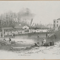 Looking across busy wharf with men resting near barrels in foreground, others standing near stacked lumber. Forest of ships' rigging in background, buildings along wharf and in right foreground