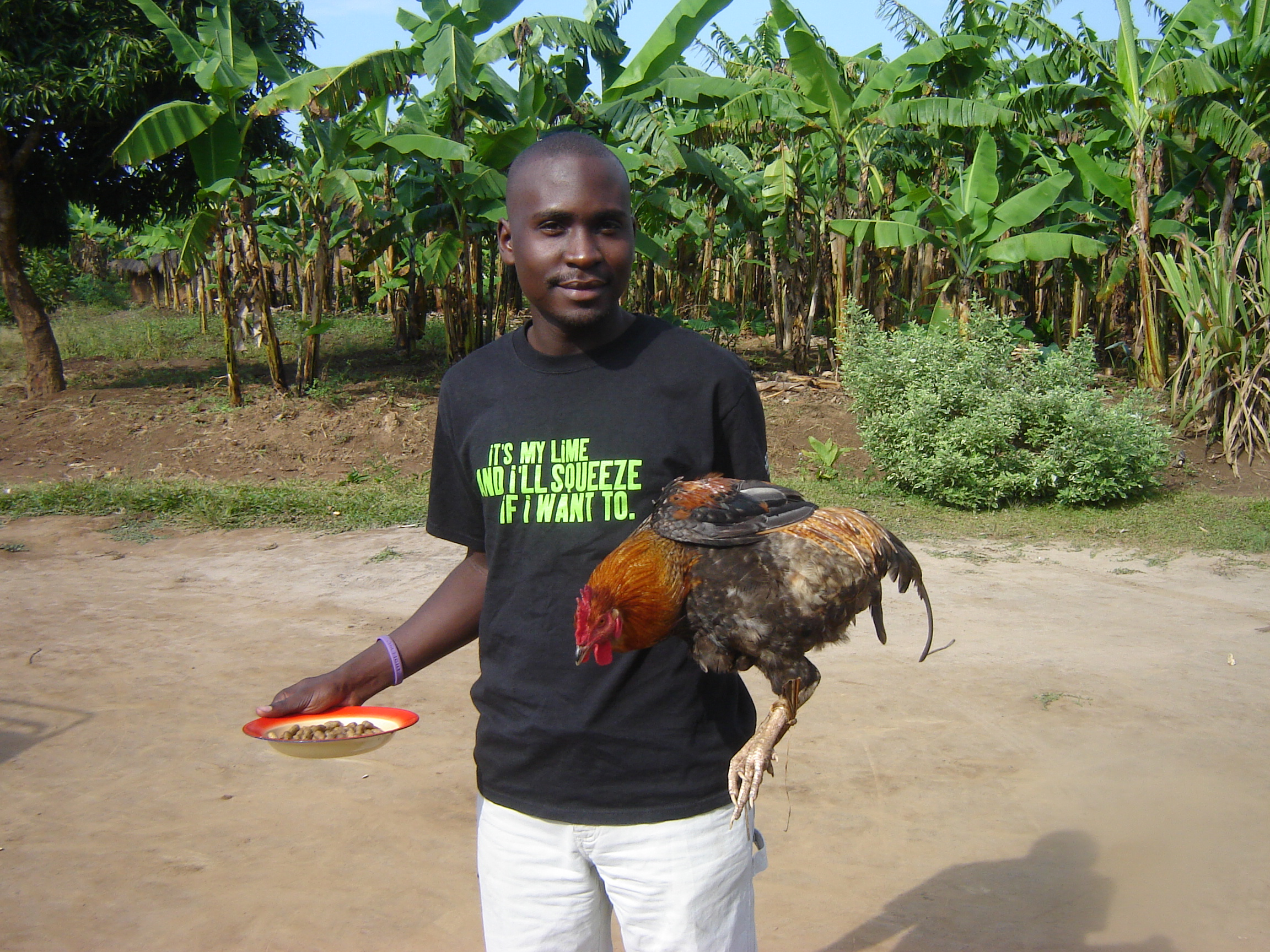"We have about 1000 pictures of Seggy...it was hard to choose just one!  This was taken in Masaka after a chicken was given by a Ugandan woman to Nkumba as a gift--as a ""thank you"" for caring for her son, Alex."