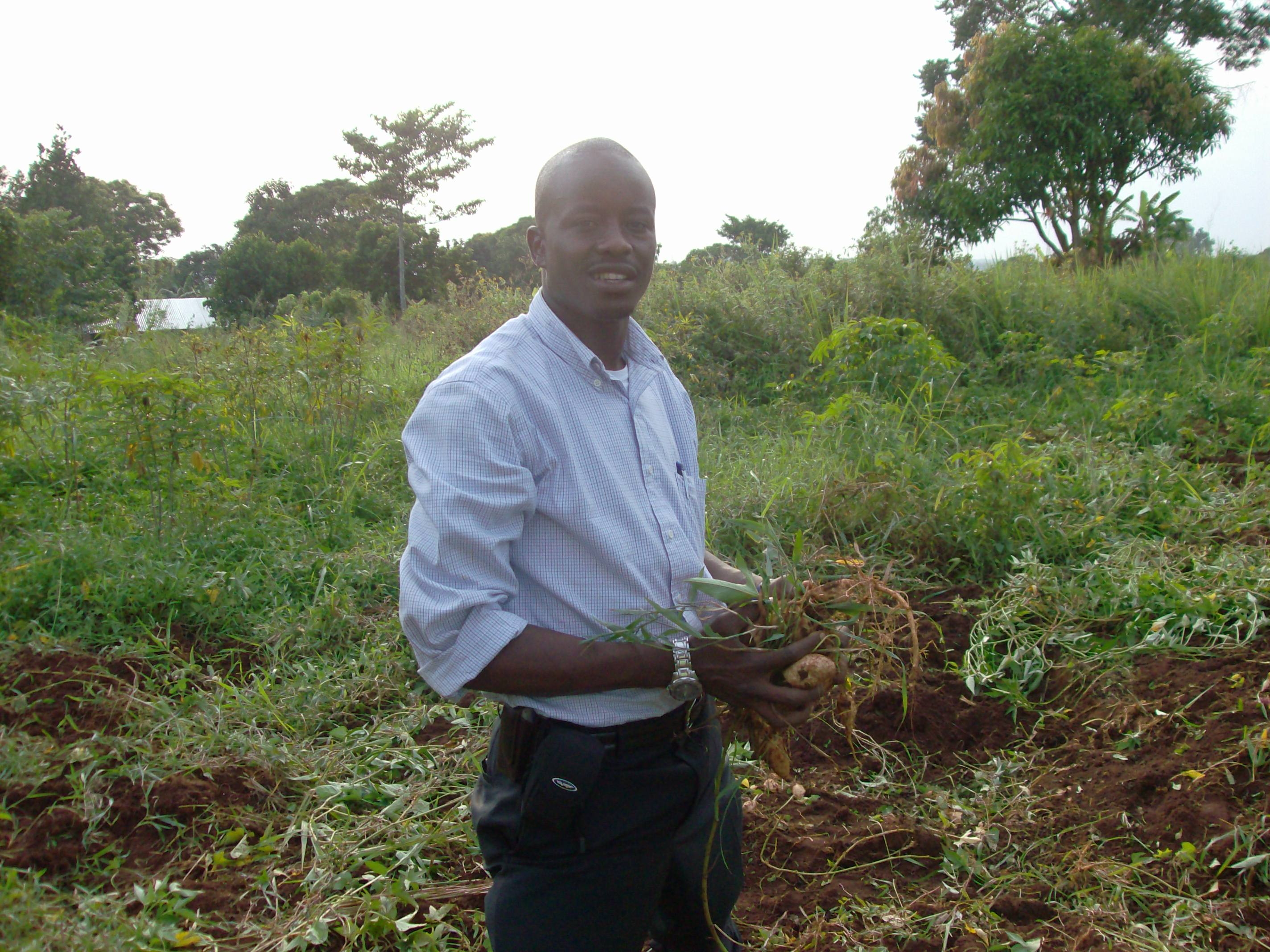 Mark, standng on his land in Uganda