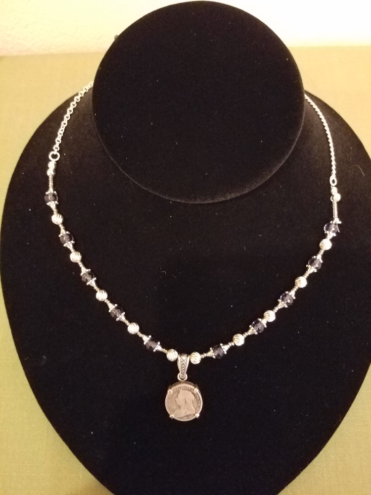 Victorian threepence on strand of silver and blue beads