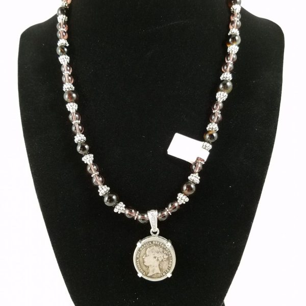 Necklace with silver Victorian coin and purple and black beads