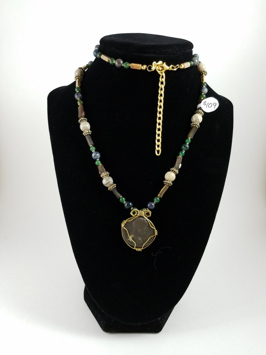 Long necklace with wire-wrapped Roman coin with green and brown beads