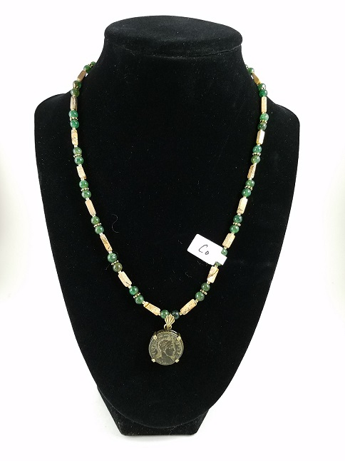 necklace featuring a Roman coin of Constantine as well as green and brown beads