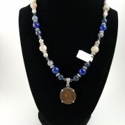 Necklace with Victorian farthing and blue lapis lazuli and white fossilized coral beads.