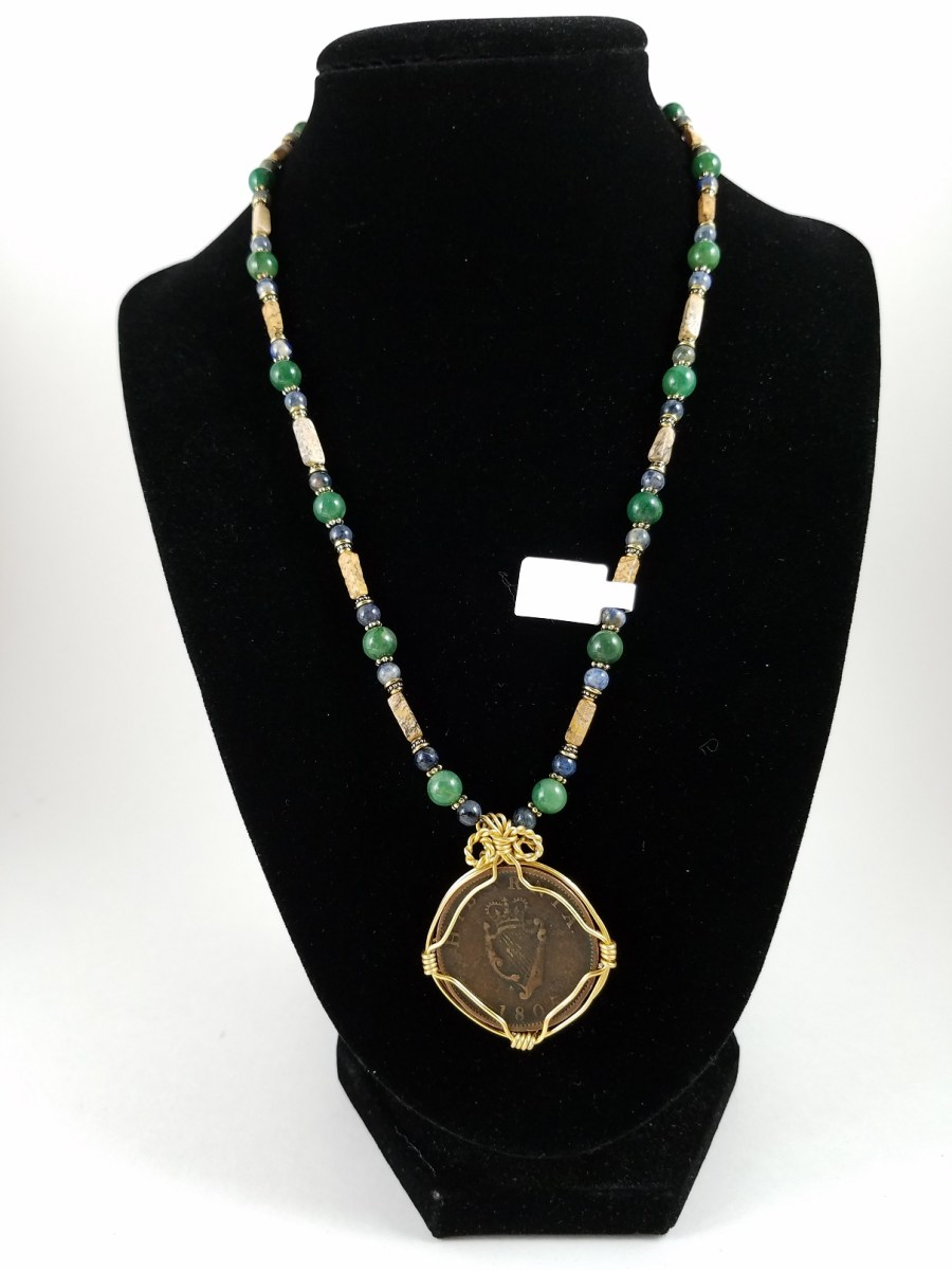 Necklace witgh 19th century Irish penny ith green adn brown beads