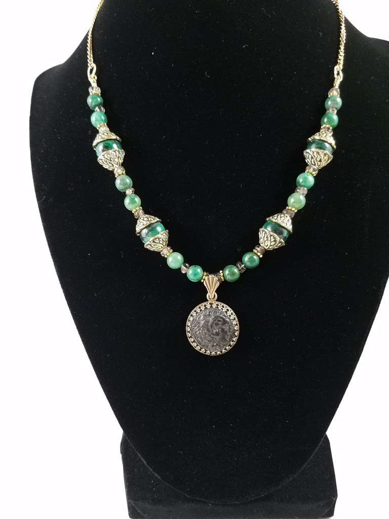 necklace featuring ancient coin of Alexander the Great with green beads, including malachite.