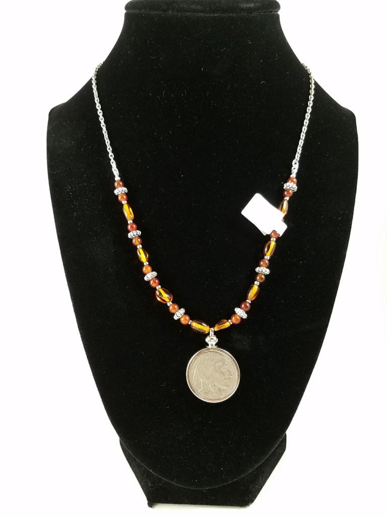 Amber necklace with Buffalo American nickel