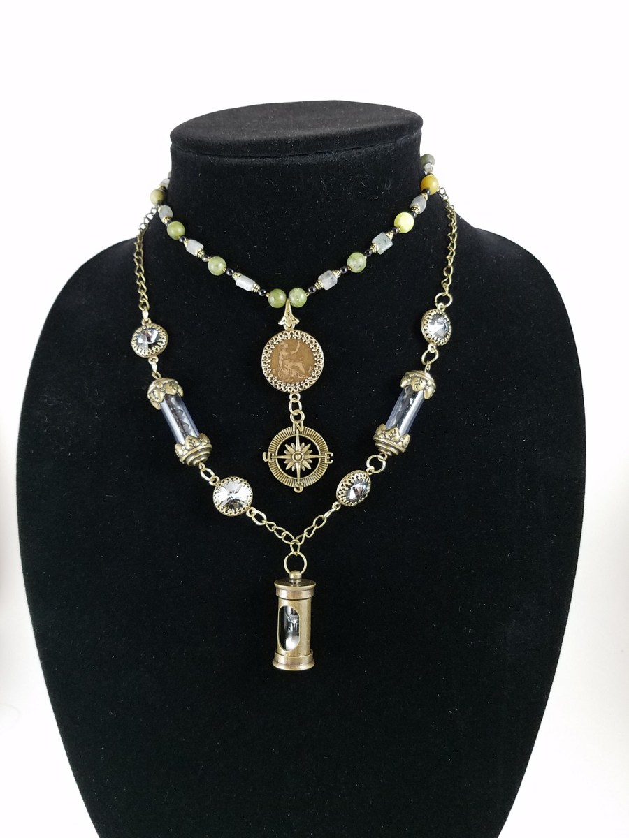 Steampunknecklace with Victorian farthing coin, hour glass, crystals, vials and compass