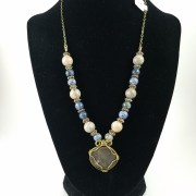 Necklace with roman wire-wrapped coin with white and blue beads
