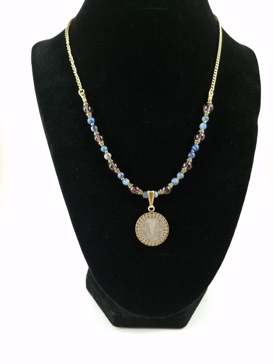 Necklace with irish coin and blue and purple beads
