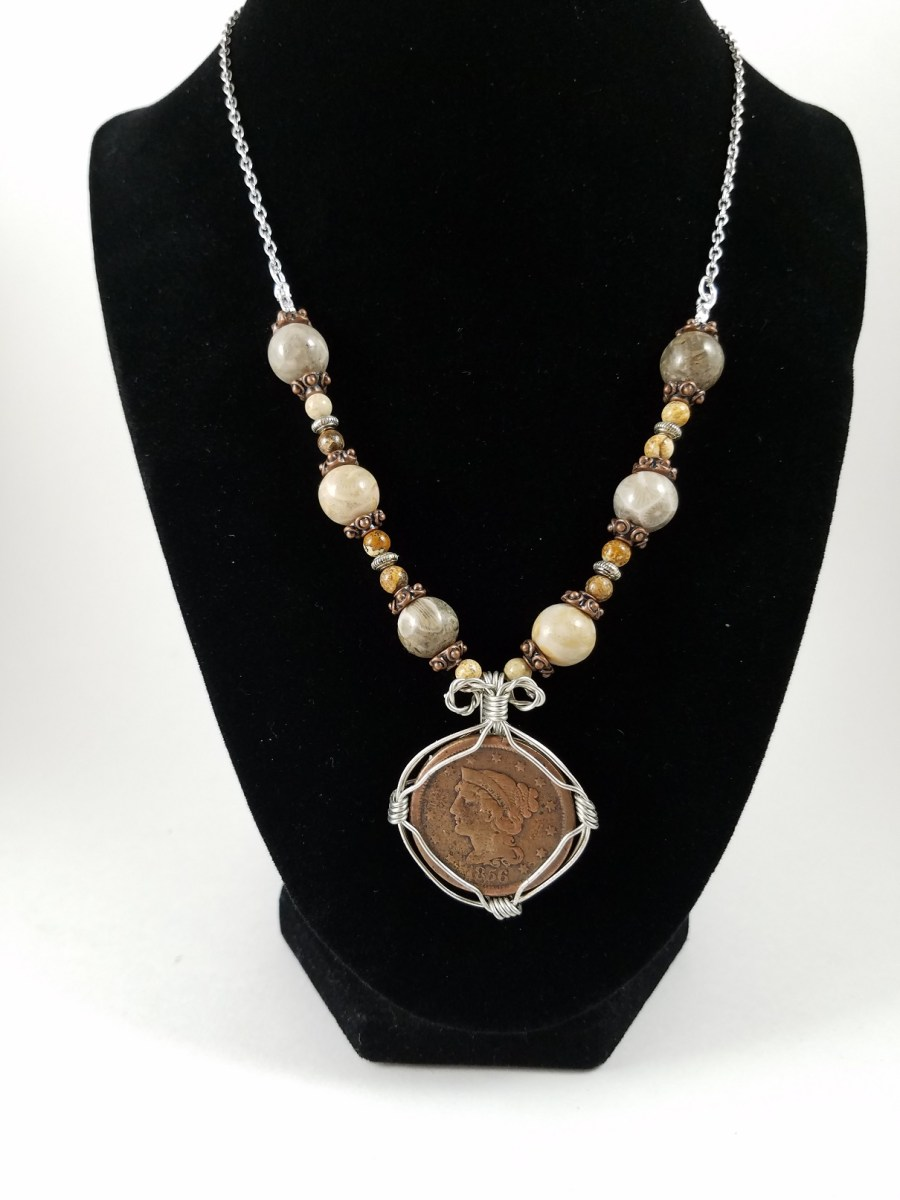 Necklace with American 19th century penny with white, brown and copper beads