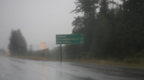Montana: rainy night, outline of trees and sign