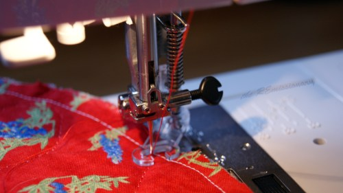 sewing around outer edge to hold layers in place