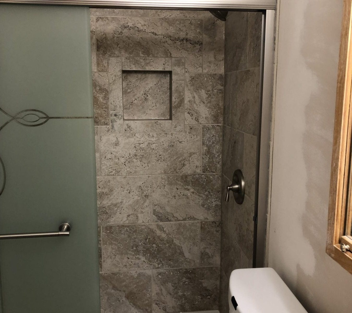 replacing fiberglass shower with tile