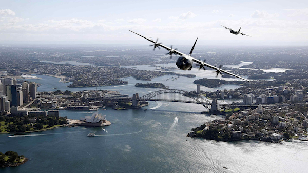 Handout shows Two Royal Australian Air Force C-130J Hercules aircraft flying above the Sydney Opera House and Sydney Harbour Bridge during a display
