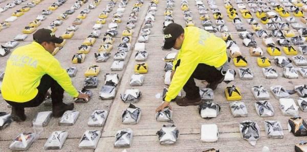 En la foto, un cargamento del Clan Usuga de tres toneladas de cocaína ocupado por la policía en Colombia en febrero pasado. (AP)