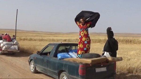 0012772527 La felicidad de las mujeres que escapan del ISIS