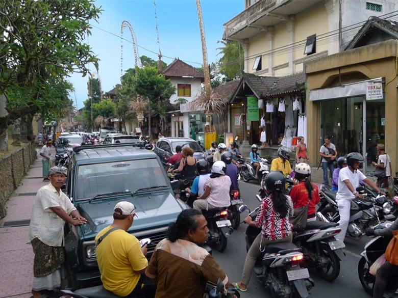 Riding a scooter through Traffic in Ubud, Bali