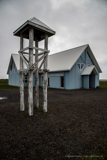 Church and bell tower approaching Höfn. Nikon D810, 24 mm (24-120.0 mm ƒ/4) 1/800 sec ƒ/8 ISO 200