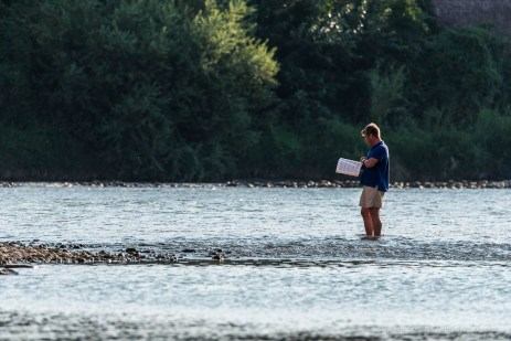 """A gentleman rehersing his part standing with his feet in the streem of the river Adige. Verona, August 2016. Nikon D750 400 mm (80-400.0 mm ƒ/4.5-5.6) 1/640"""" ƒ/8 ISO 320"""