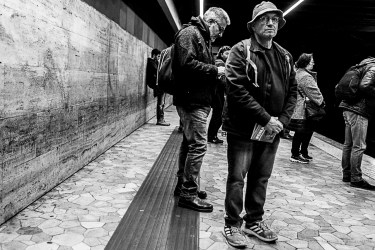 People waiting for the next train on Line B. Nikon D810, 35 mm (35.0 mm ƒ/2) 1/160 ƒ/8 ISO 140