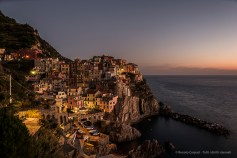 View of Manarola at dusk from the Cemetery. Nikon D810, 24mm (24 mm ƒ/1.4) 4 sec ƒ/6.3 ISO 64