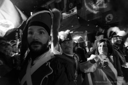 """Domenica Venditti, """"Mugnaia"""", with the """"Generale"""" Claudio Ferrero in the Borghetto district at the Ivrea Carnival. Nikon D810, 24 mm (24-120 mm ƒ/4) 1/125"""" ƒ/4 ISO 6400"""