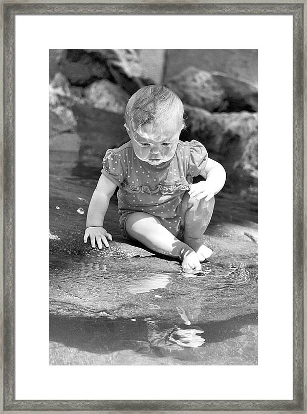 Baby Framed Print featuring the photograph Discovering A Friend by Maria Jansson