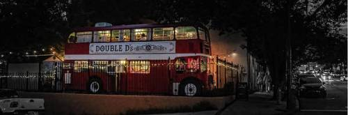 Downtown Asheville after dark, featuring Double D's double decker bus.