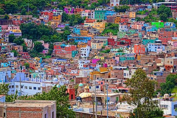 Colorful hilltop buildings in Guanajuato Mexico by Tatiana Travelways