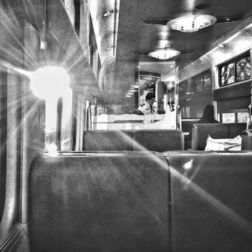 The dining car with a sun flare by Sharon Popek