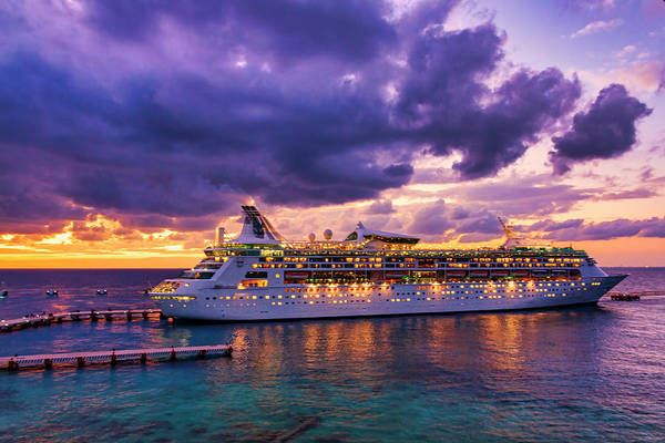 Cruise ship arriving in Cozumel, Mexico at dusk