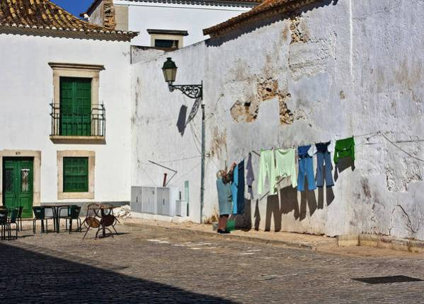 Estoi Art Print featuring the photograph Laundry day in Estoi, Portugal by Tatiana Travelways