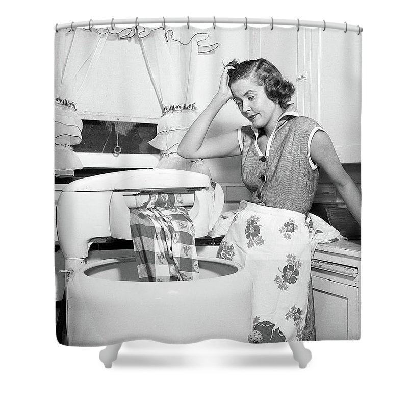 1950s frustrated housewife with jammed shower curtain