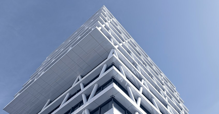 Building Facade elevation white metal skeleton structure with glass and blue sky above