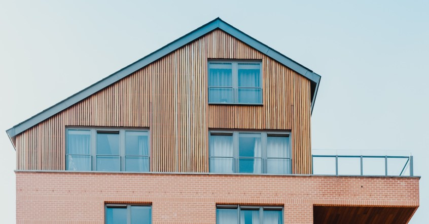 Timber clad extension on top of a brick building