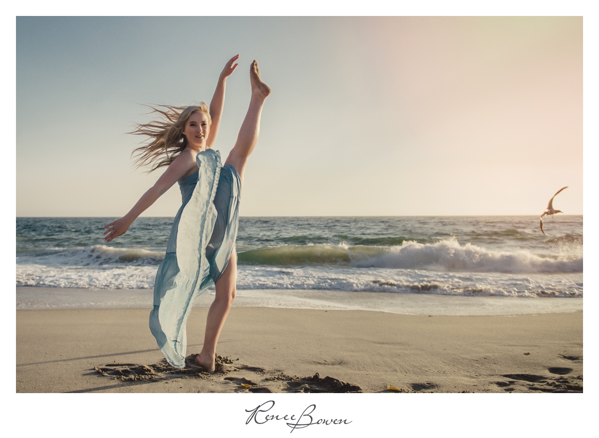 ballerina kicking at beach