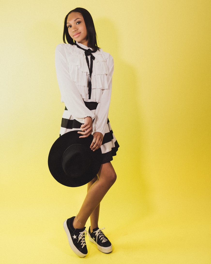 girl on yellow backdrop photoshoot
