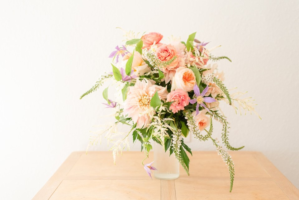 peach and greenery bouquet for bride at Rehoboth Beach with Renee Nicolo Photography