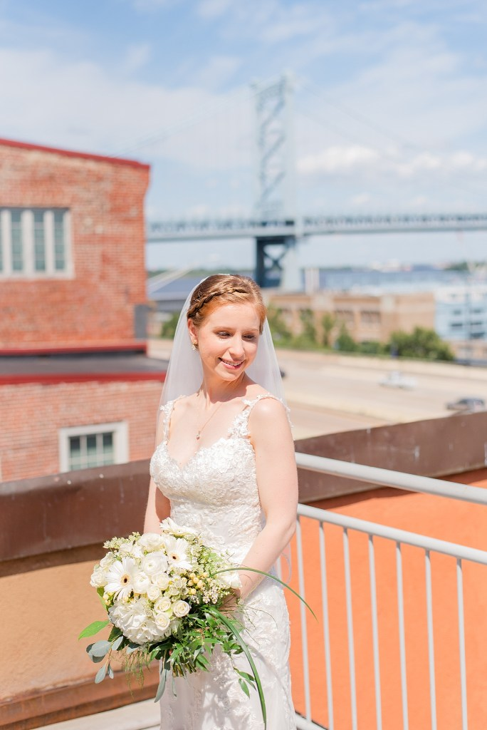 Renee Nicolo Photography photographs Philly bridal portraits on Penn's View rooftop