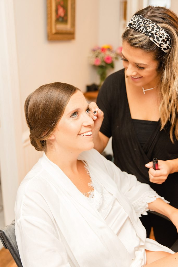 bride has makeup done for PA wedding with Renee Nicolo Photography
