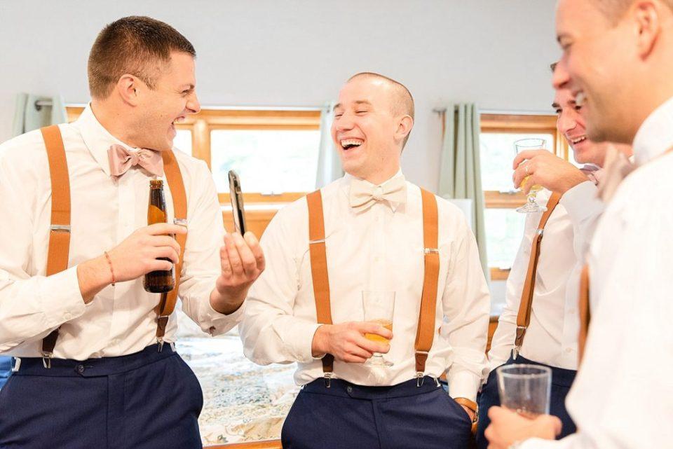 groom and groomsmen prep for New Hope PA wedding with Renee Nicolo Photography