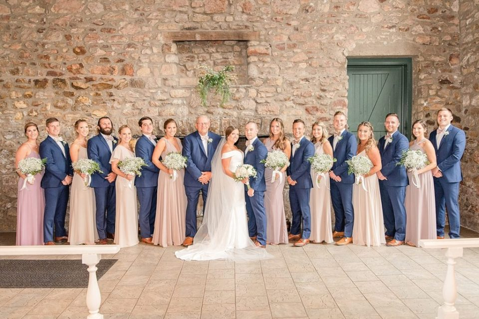 bridesmaids and groomsmen pose for photo with Renee Nicolo Photography
