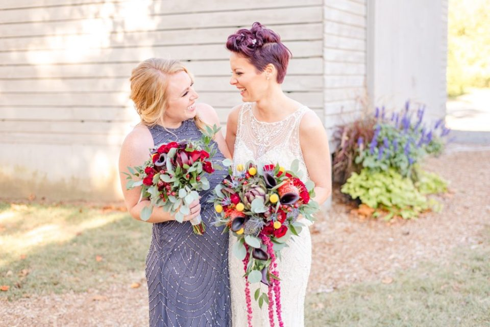 bride and bridesmaid laugh on wedding day in PA with Renee Nicolo Photography