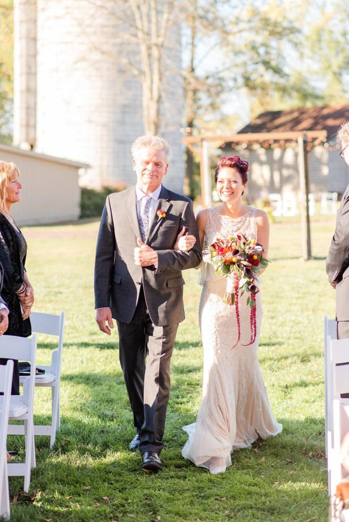 bride and dad enter wedding ceremony at Historic Stonebrook Farm photographed by Renee Nicolo Photography