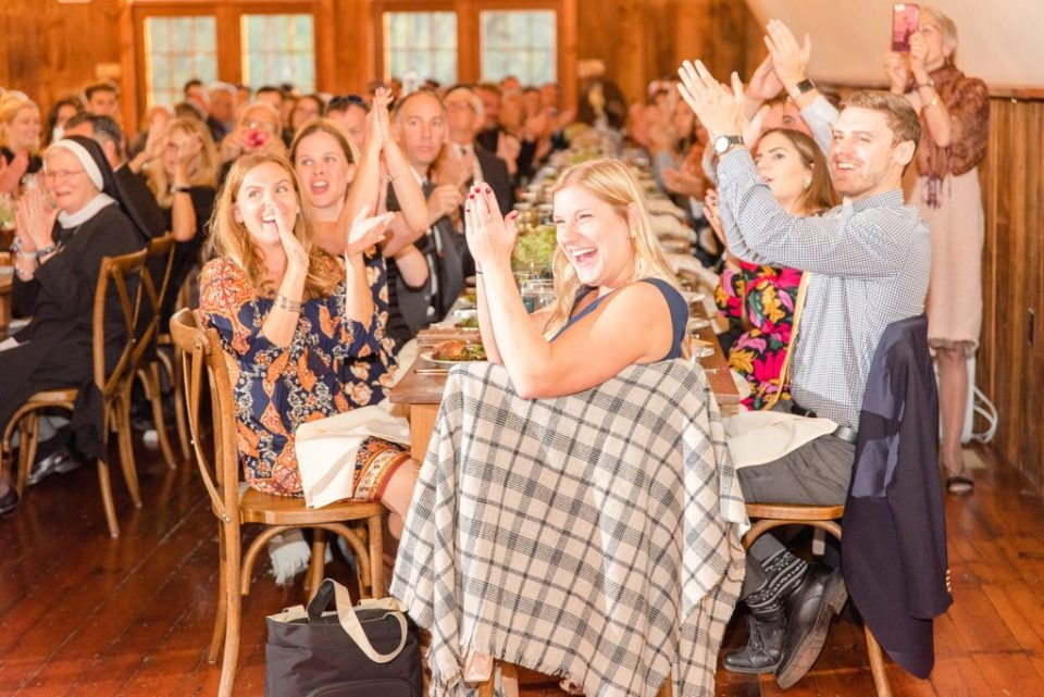 guests cheer newlyweds photographed by Renee Nicolo Photography